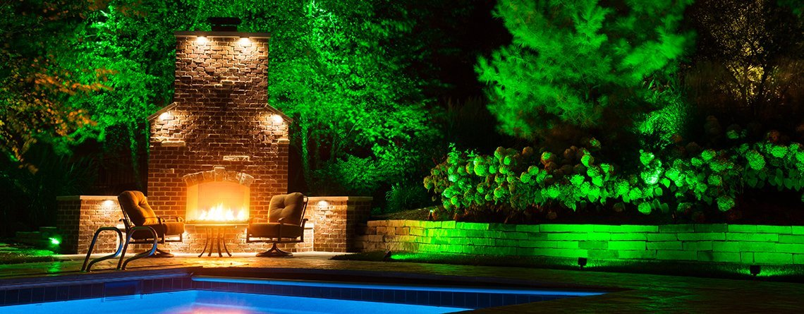 Green lighting at pool and fireplace