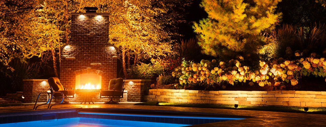 Yellow lighting at pool and fireplace, yard care