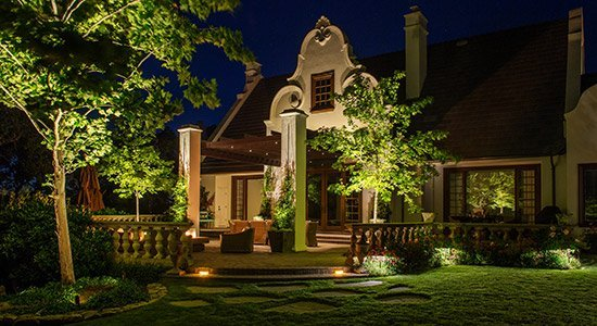 house with green lights, yard care