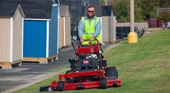 mowing a lawn in a business parking lot
