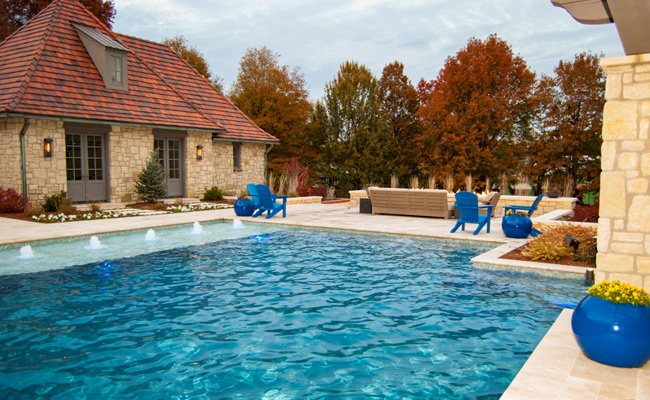 pool next to house with red brick, pool services